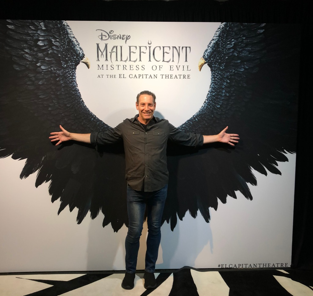 A guest, trying out the Maleficent wings. Photo by Karen Salkin.