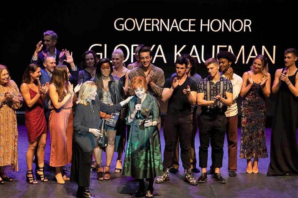 Glorya Kaufman in the green dress in the center, with Anita Mann in black. Photo by Steve Sasaki.