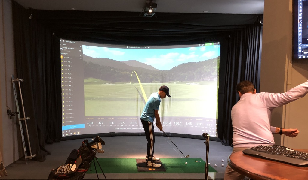 A student and instructor in one of the golf simulators. Photo by Karen Salkin.