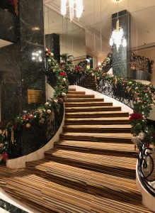My favorite staircase iin town, all dressed-up for the holidays. Photo by Karen Salkin, as is the one at the top of this page.