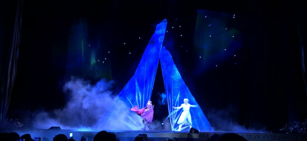 Anna and Elsa on stage at the El Capitan, enjoying the light show. Photo by Karen Salkin.