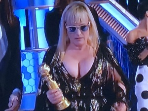 Patricia Arquette and her massive boobs.  I guess she figures no one will look at her awful teeth if she pops those suckers out! Photo by Karen Salkin.