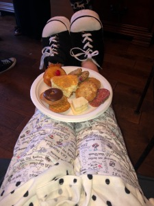 A plate of desserts, balancing on my legs.  It's just a clever way to show-off my adorbs over-sized Little Lulu sneakers SLIPPERS!  Photo by Karen Salkin.