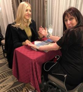 Lisa Greenfield reading Karen Salkin. Photo by INAM staff.