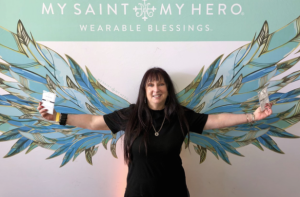 Karen Salkin, spreading her wings, (with a bracelet in each hand!) Photo by Marisa Marshall.