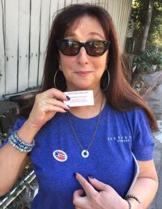"Karen Salkin displaying her ""I Voted"" sticker...four years ago!  (She wore that same shirt, and nail polish, to the polls yesterday! And she still looks the same!) Photo by Mr. X. (The photo at the top of this page is by Karen Salkin.)"