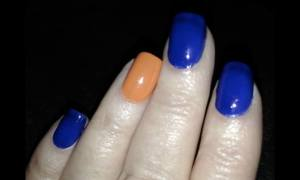 "Karen's simple ""Tribute to the Mets"" self-polished nails, back when sports could be played!  Photo by Mr. X."