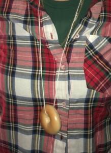Karen Salkin modeling her Nate 'n Al's mini-bagel necklace.  Photo by Mr. X.