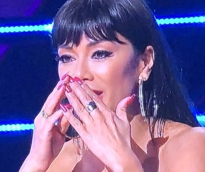 Masked Singer judge Nicole Scherzinger.  She's had so much facial surgery that her visage looks plastic now.  But she cannot disguise her wrinkly hands.  Photo by Karen Salkin.