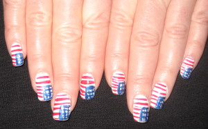 My flag nails one recent year.  (This pic was taken about ten days after I handpainted this design, so they're already a tad messy.) Photo by Mr. X.