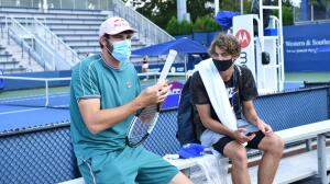American tennis players Reilly Opelka and Taylor Fritz getting ready for the US Open.  At least they're wearing masks.