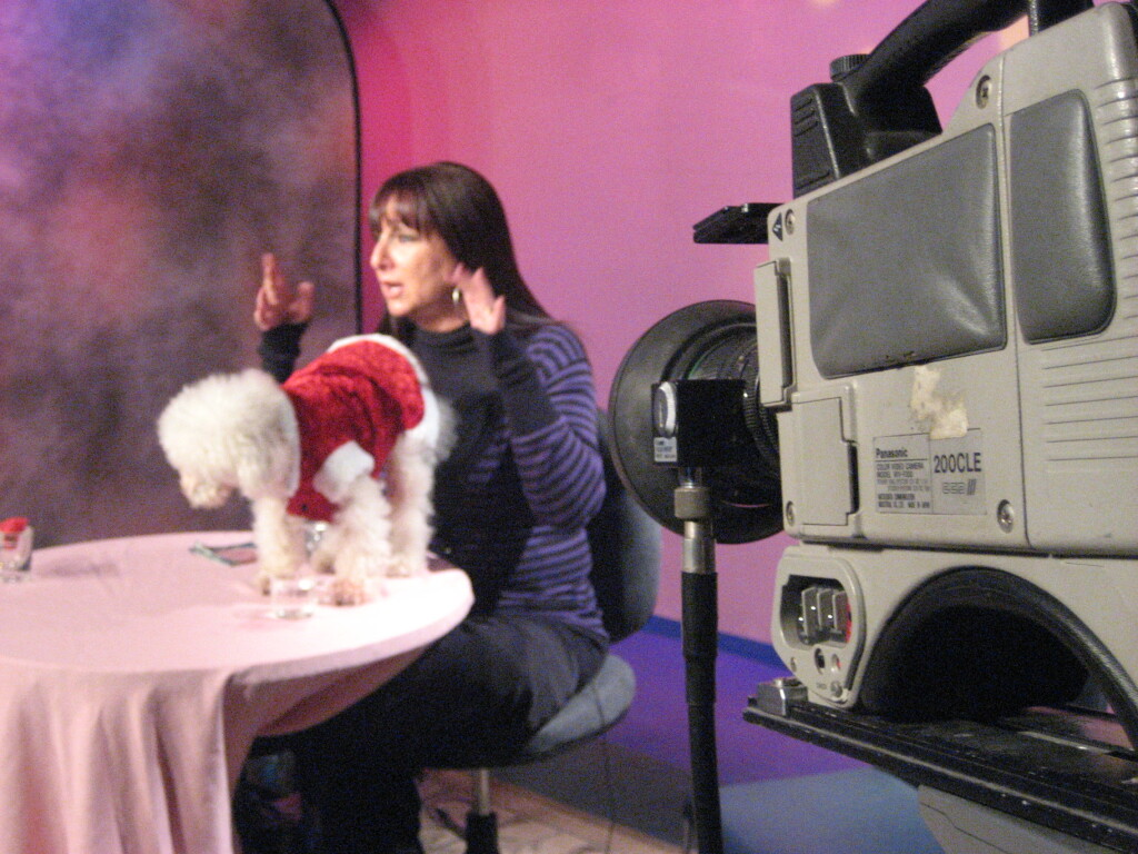 A behind-the-scenes look at Karen Salkin and Clarence, the Singing Dog, getting ready to host Karen's Restaurant Revue, back in the day.  Photo by INAM staff.