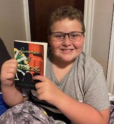 Marcus Jocelyn about to start reading Summer of L.U.C.K. Photo by Amanda Hazel.