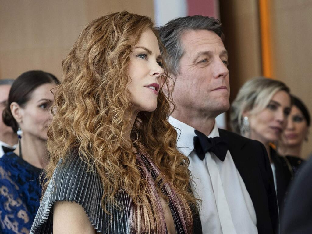 Nicole Kidman and Hugh Grant at their characters' son's school's fundraiser.