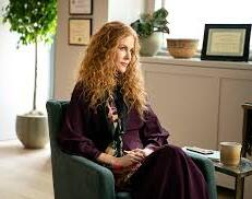 Nicole Kidman, counselling her patients, with her telltale phone beside her.