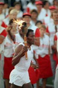 Rafer Johnson lighting the Olympic Torch at the 1984 Olympics in Los Angeles.
