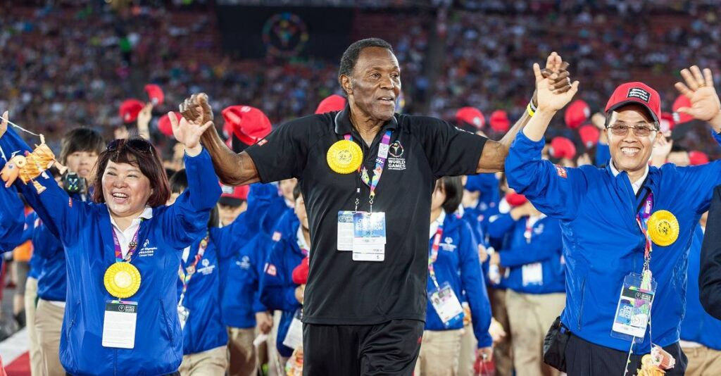 Rafer Johnson leading the opening of a California Special Olympics.