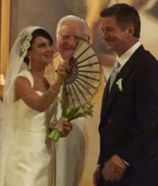 """The wedding of Hilaria and Alec Baldwin, into which she put Spanish accents, such as the """"pericon"""" with which she's fanning her husband."""