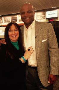 Karen Salkin with Warren Moon, the tenth black quarterback in NFL history.  Photo by Alice Farinas.