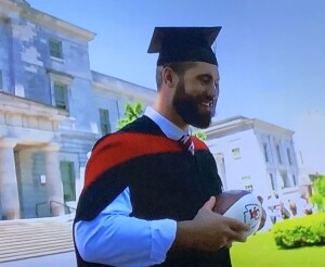 Dr. Laurent Duvernay-Tardif, featuring both his occupations--graduating from med school while holding his beloved Chiefs football! Photo by Karen Salkin.