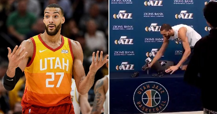 "Rudy Gobert.  On the right, he's ""playfully"" spreading his germs, (which, in all fairness, he did not know he had,) to all the microphones in the Press Room!"