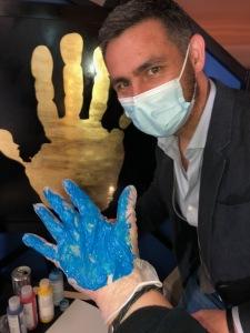 Artist Johnathan Schultz with Karen Salkin's right hand. Photo by Karen Salkin's left hand!