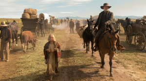 Helena Zengel (walking) and Tom Hanks on horseback, leading the way, in News of the World.