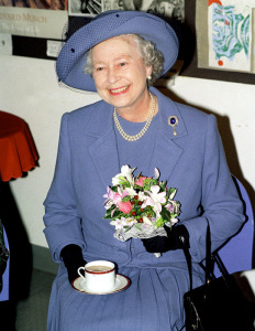 I  adore this picture of Queeen Elizabeth looking so happy with her cuppa and bouquet!