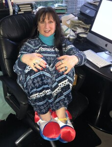 Karen Salkin hard at work  in her  latest PJs and clown slippers.(Yes, her desk was a mess that day!)  Photo by Mr. X.