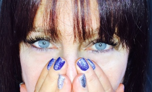 Karen Salkin, using her polished nails as a mask. Photo by Mr. X.