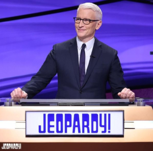 Anderson Cooper, looking like a natural at the Jeopardy podium!