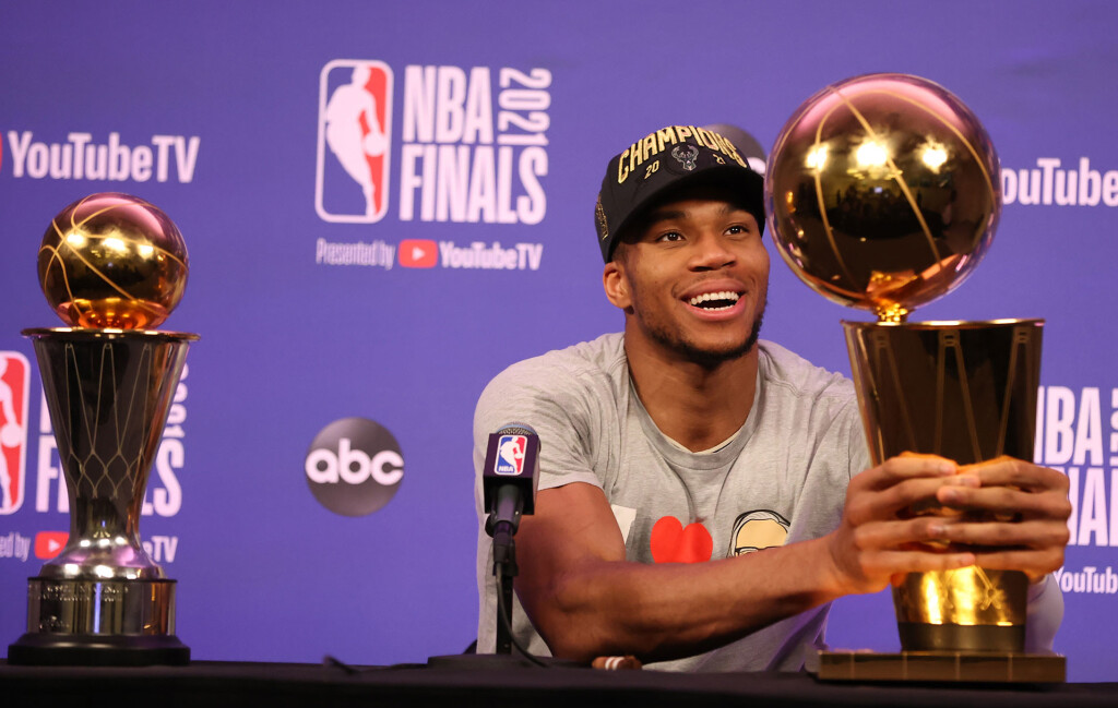 Giannis Antetokounmpo loving the team's Championship trophy even more than his individual MVP one.