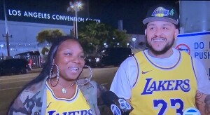 """Two idiototic Lakers """"fans"""" on the local news, giddily blaming LeBron James for the teams' first round exit from the play-offs. Photo by Karen Salkin."""