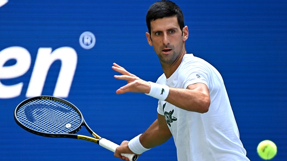 Look at the crazy look in Novak's eyes.  And this is just practice!