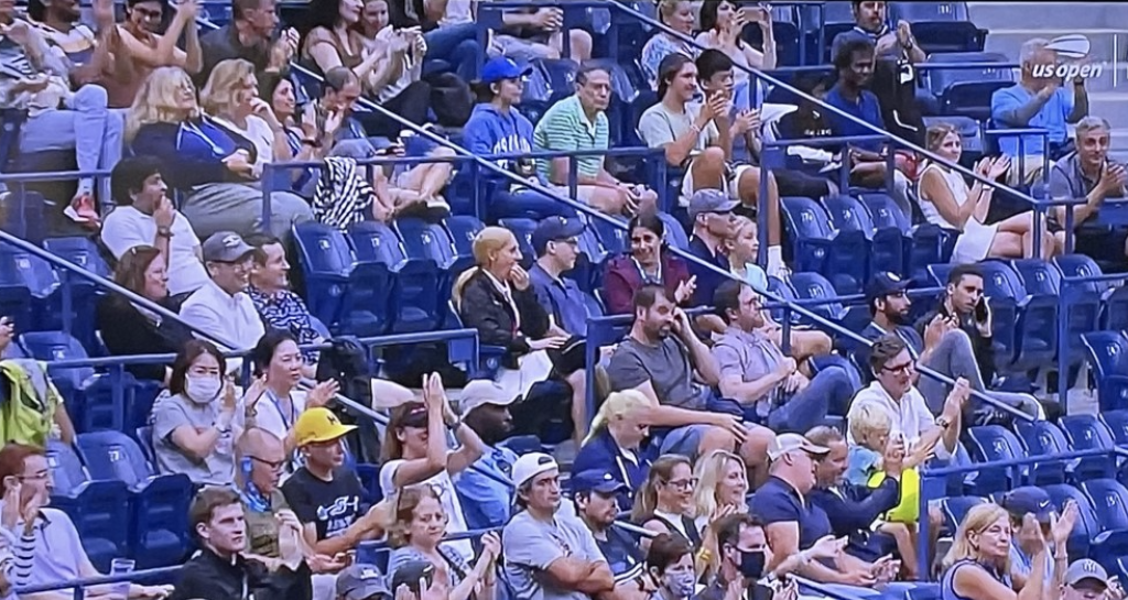 People at last week's US Open, with the roof closed, which requires them to wear masks.  As you can see, unbelievably few complied.  And the tournament did nothing to enforce the rule. Photo by Karen Salkin, off TV.