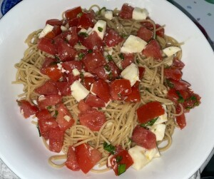 One of the many healthful meals I've made during the lockdown.  It's whole wheat pasta topped with checca, which is basically a sauce of room temperture tomatoes.  The recipe is in my Recipes section (duh) if your mouth is watering now. Photo by Karen Salkin.